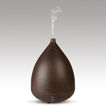 Pure essential oil diffuser dark wood grain texture